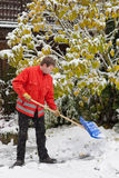 Adult man clean owns road to home against snow Royalty Free Stock Photo