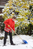 Adult man clean owns road to home against snow Stock Images