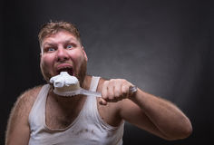 Adult man cleaning teeth Royalty Free Stock Photo