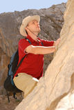 Adult man climbing on rock Stock Photography