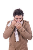 Adult man in the coat covers the face with scarf Royalty Free Stock Image