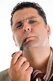 Adult man in coat smoking tobacco pipe Royalty Free Stock Image