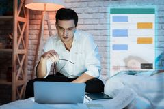 Adult man communicates in chat at night. Confident businessman is chatting in messenger. royalty free stock photo