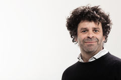 Adult man with curly hair Royalty Free Stock Image
