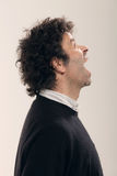 Adult man with curly hair Royalty Free Stock Photo