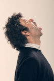 Adult man with curly hair Royalty Free Stock Photos