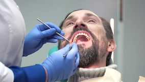 Adult man at the dentist. stock footage