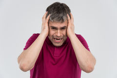 Adult man in depression with hands on head. Royalty Free Stock Images