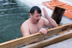 Adult man dive. Yoshkar-Ola, Russia - January 19, 2017 Adult man dive into an ice hole in the feast Epiphany royalty free stock photos