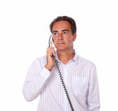 Adult man doing a phone conversation Stock Image