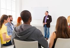 Adult man doing presentation in office copy space Royalty Free Stock Image