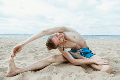 Adult man doing yoga Stock Photography