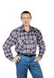 Adult man dressed in jeans and a plaid shirt Royalty Free Stock Photo