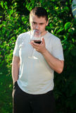 Adult man drinking wine Royalty Free Stock Image