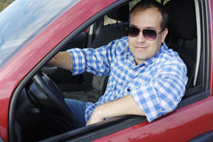 Adult man is driving his car Royalty Free Stock Images