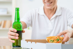 Adult man eating pizza Royalty Free Stock Photos