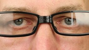 Adult man in eyeglasses extremely close-up view. Thinking looking around. stock video