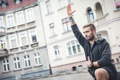 Adult man in a fitness training outside. Stock Image