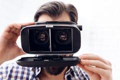 Adult man fools around using virtual reality glasses. royalty free stock photos