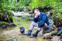 Adult man in forest relaxing Stock Image