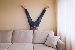 Home leisure activity spring cleaning. Adult man hand standing behind sofa in the room. Home leisure activity spring cleaning dust allergy concept Royalty Free Stock Image