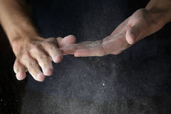 Adult man hands work with flour Stock Images