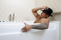 Man bathes in a bathroom Stock Photography