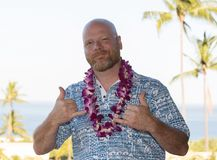 Adult man on Hawaiian vacation wearing a fresh orchid lei Stock Image