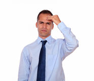 Adult man with headache holding his forehead Royalty Free Stock Image