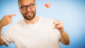 Adult man with heart on stick royalty free stock photo