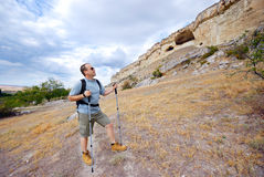 Adult man is hiking with his backpack Royalty Free Stock Photos