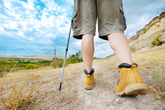 Adult man is hiking with trekking poles stock images