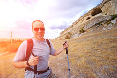 Adult man is hiking with trekking poles Royalty Free Stock Photography
