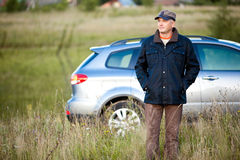 Adult man and his car Stock Photography