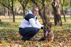 Adult Man With His Dog Royalty Free Stock Image