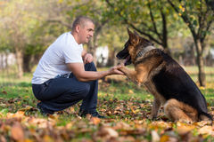 Adult Man With His Dog Royalty Free Stock Photos
