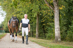 Adult Man With His Horse Royalty Free Stock Image