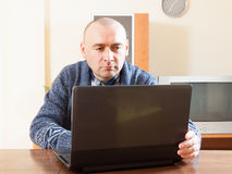 Adult man  at his laptop Royalty Free Stock Photo
