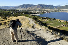 Adult Man Hobby Photographer. Photographing landscapes in Penticton located the Okanagan Valley for British Columbia, Canada Stock Photo
