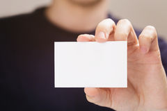 Adult man hold business paper card closeup Royalty Free Stock Images
