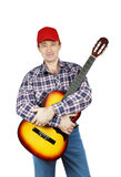 Adult man holding a guitar Royalty Free Stock Photos