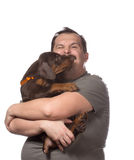 Adult man is holding his sweet puppy isolated on white backgroun Stock Photography