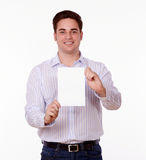 Adult man holding up a blank card of copyspace Stock Photos