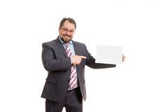 The adult man holds a sheet of paper Royalty Free Stock Photos