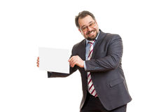 The adult man holds a sheet of paper Stock Image