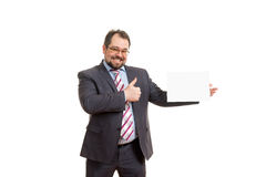 The adult man holds a sheet of paper Stock Photo