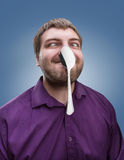 Adult man holds a spoon on his nose Royalty Free Stock Photos