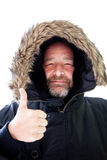 Adult Man in Hooded Jacket Showing Thumbs Up. Close up Smiling Adult Man Wearing Fur Lined Hooded Jacket Showing Thumbs Up Hand Sign While Looking at the Camera Stock Images