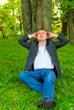 Adult man in a jacket relaxing Stock Photos