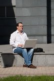 Adult man with laptop Stock Images